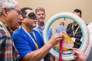 Assembling bikes blindfolded. (left)