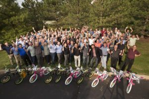 How many sales and marketing people does it take to make a bicycle? Conair sales team celebrates charitable effort