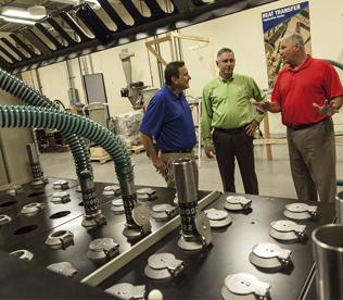 Conair staff discussing equipment